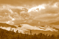 Glowing Sepia Mountain Clouds